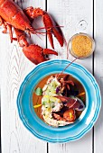 Lobster bisque with a grilled lobster