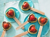 Heart-shaped muffins on sticks
