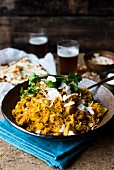 Chicken biryani with coconut flakes and parsley