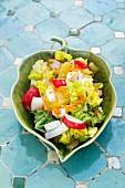 Potato salad with radishes, carrots and feta cheese