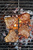 Lamb steaks on a barbecue