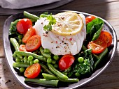 Cod fillet on a bed of vegetables
