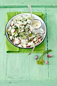 Radish salad with cauliflower, cucumber and a yoghurt and herb mayonnaise