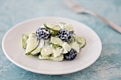 Cucumber salad with blackberries, yoghurt and dill