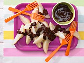 Steamed pear wedges with chocolate sauce