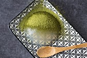 A raindrop cake with matcha tea powder (Japan)