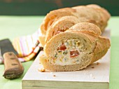 A baguette with a vegetable, egg and quark filling