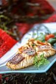 Fried salmon fillet on a serving platter