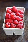 Fresh raspberries in a paper punnet