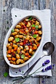 Bean stew with lavender flowers