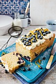 Blueberry loaf cake with cream cheese frosting and orange zest, sliced