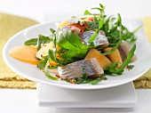 Fruity soused herring salad with melon