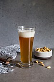 Wheat beer and roasted peanuts