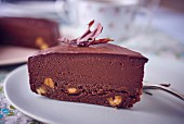 A slice of chocolate mousse cake (close-up)