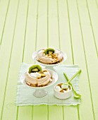 Mini pavlovas with passion fruit cream and kiwi