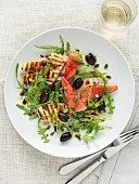Rocket salad with grilled cheese, watermelon and olives