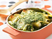 Asparagus cannelloni covered in cheesy spinach sauce