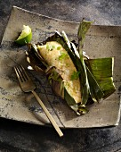 Salmon with galangal wrapped in a banana leaf