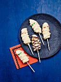 Banana mummies: bananas on sticks covered in white chocolate