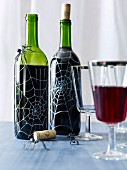 Halloween wine bottles decorated with spiderwebs