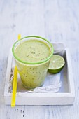 A pineapple and kiwi smoothie made with coconut water