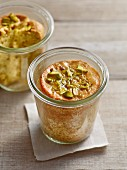 Pistachio and rose water cakes in glass jars