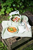 Couscous salad, tomato & cucumber salad and yoghurt dressing for a picnic
