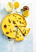 Lemon and passion fruit tart, sliced