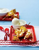 Pineapple kebabs with coconut and vanilla ice cream