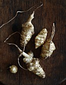 Jerusalem artichokes on a wooden surface