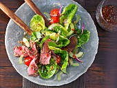 Hot Thai salad with steak strips
