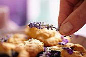 Decorating blueberry & lavender biscuits with lavender flowers
