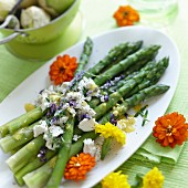 Green asparagus with cheese and edible flowers