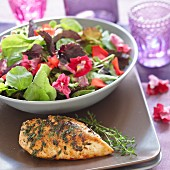 Grilled chicken breast with a mixed salad