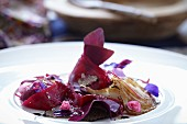 Beetroot with onion, truffle and edible flowers