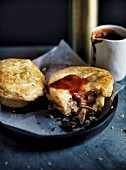 Lamb and anchovy pies with tomato sauce