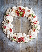 A pavlova advent's wreath with redcurrants