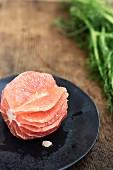 A peeled pink grapefruit