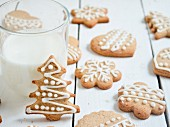 Gingerbread biscuits decorated with royal icing and a glass of milk