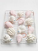 Animal meringues on a cooling rack