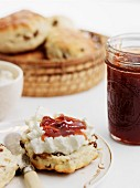 A scone with clotted cream and apple chutney