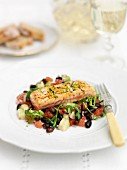 Seared salmon on a bed of vegetable salad