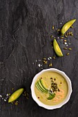 Chilled avocado soup with pumpkin seeds (seen from above)