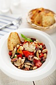 Anchovy salad with shiitake mushrooms, white beans and pepper