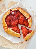 A sliced strawberry and balsamic vinegar tart