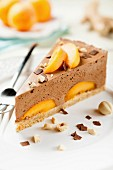 A slice of chocolate mousse cake with apricots