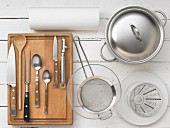 KItchen utensils for preparing vegetable soup with rice and beef