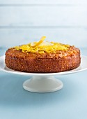 Lemon drizzle cake on a cake stand