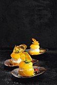 Filled yellow tomatoes with spicy orange syrup and vanilla ice cream