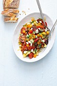 Colourful tomato salad with sheep's cheese